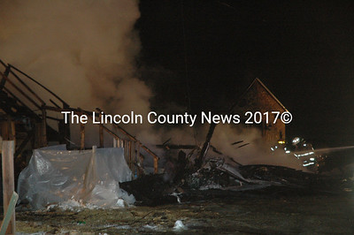Firefighters from Kennebec, Knox, and Lincoln County departments responded to a fire that destroyed a two-story building in Jefferson the evening of Wednesday, Dec. 28. (Alexander Violo photo)