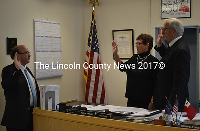 Maine Secretary of State Matthew Dunlap (left) administers the oath of office to Lincoln County Commissioners Mary Trescot and Hamilton Meserve at the county courthouse in Wiscasset on Tuesday, Jan. 3. (Abigail Adams photo)