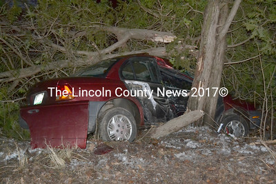 A Saturn crashed into trees the late afternoon of Sunday, Jan. 1 after hitting a patch of black ice on Route 32 in Waldoboro that caused another accident two days earlier. (Abigail Adams photo)