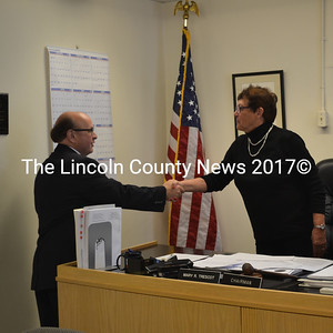 Maine Secretary of State Matthew Dunlap congratulates Mary Trescot after swearing her in to her second term as Lincoln County commissioner for District 3. (Abigail Adams photo)