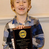 Matthew Roberts, 6, of Damariscotta, captured gold in the Youth Division with his license plate display at the Colonial Region fall meet of the Automobile License Plates Collectors Association.