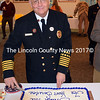 Bristol Fire Chief Paul Leeman Jr. cuts the cake during a reception in honor of local first responders at the Congregational Church of Bristol on Sunday, Nov. 19. (J.W. Oliver photo)