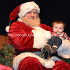 Santa Claus holds 6-month-old Camden Gordon, of Bristol, at the Lincoln Theater in Damariscotta on Sunday, Nov. 25. Santa was in town for the Villages of Light celebration. (J.W. Oliver photo)