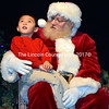 Shaun Pheng, 4, of Jefferson, discusses his Christmas wishlist with Santa Claus at Lincoln Theater in Damariscotta on Saturday, Nov. 25. (J.W. Oliver photo)