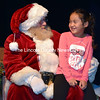 Santa Claus hears from Shayla Pheng, 7, of Jefferson, at Lincoln Theater in Damariscotta on Saturday, Nov. 25. (J.W. Oliver photo)