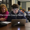June Shaw looks on as her son, David Shaw, plays a coding game in the Great Salt Bay Community School cafeteria Thursday, Nov. 8. (Maia Zewert photo)