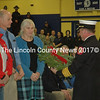 Waldoboro Fire Chief Paul Smeltzer presents a wreath to Union town officials. (Alexander Violo photo)