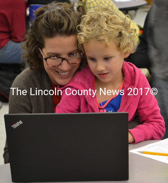 Amy Minzner works with her daughter, Lina Minzner, on a computer program. (Maia Zewert photo)