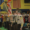 Knox and Lincoln County sheriff's deputies stand at attention as Medomak Valley High School students perform the national anthem. (Alexander Violo photo)