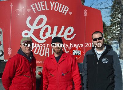 From left: Colby & Gale Inc. drivers Ralph Eugley and Tim Pratt and manager Matt Poole with a specially decorated oil truck on Valentine's Day. Colby & Gale was participating in a statewide event called Fuel Your Love. (Maia Zewert photo)