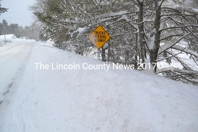 The MaineDOT road signs on Biscay Road in Damariscotta are overtaken by the snow on Monday, Feb. 13. (Abigail Adams photo)