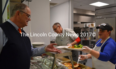South Bristol School Kitchen Manager Jessica Chadwick serves Central Lincoln County School System Superintendent Steve Bailey a plate of lasagna Wednesday, Feb. 15. (Maia Zewert photo)