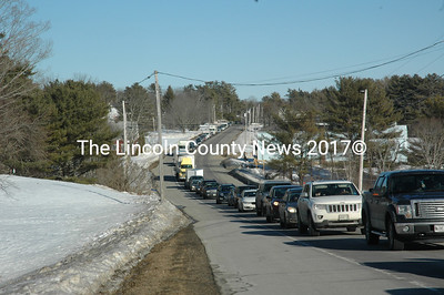 Emergency workers closed one lane of Route 1 during the response to a three-vehicle accident at the intersection with East Pond Road the afternoon of Monday, Feb. 20. The accident backed up traffic in both directions. (Alexander Violo photo)