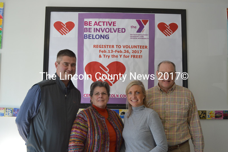 In an effort to help the town of Damariscotta remedy inadvertent violations of grant agreements from the 1980s, the Central Lincoln County YMCA plans to give land to the town. From left: YMCA Board of Directors Chair Dennis Anderson, Damariscotta Board of Selectmen Chair Robin Mayer, CLC YMCA CEO Meagan Hamblett, and Damariscotta Town Manager Matt Lutkus at the CLC YMCA on Friday, Feb. 17. (Maia Zewert photo)