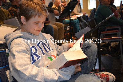 "Andrew Lyndaker, who plays Michael Banks in Lincoln County Community Theater's upcoming production of ""Mary Poppins,"" buries himself in a book while awaiting his turn to sing. (Christine LaPado-Breglia photo)"