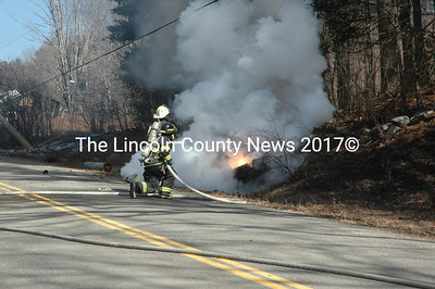 Jefferson and Newcastle firefighters responded to a car crash and resulting fire on South Clary Road on Sunday, March 12. (Alexander Violo photo)