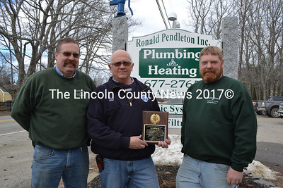 Ronald Pendleton Inc. owners Jared Pendleton (left) and Brad Pendleton (right) accept a plaque of appreciation from Bristol Fire Chief Paul Leeman Jr. for their support of Bristol Fire & Rescue. Brad is a captain with the department and Jared is the 1st assistant chief. (Maia Zewert photo)