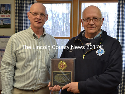Bristol Fire Chief Paul Leeman Jr. (right) presents a plaque of appreciation to Bill Crider, of J. Edward Knight & Co. in New Harbor. A former captain of Bristol Fire & Rescue, Crider is an active member of the department. (Maia Zewert photo)