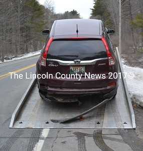 A Honda CR-V is towed from the scene of a rear-end collision on Route 27 in Wiscasset the evening of Tuesday, March 21. (Abigail Adams photo)
