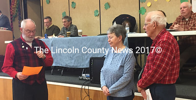 Whitefield Selectman Frank Ober (left) reads a statement about Spirit of America Award recipients Barbara and David Hayden during the annual town meeting Saturday, March 18. (Maia Zewert photo)