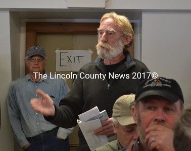 Head Tide Dam Committee member Ralph Hilton speaks in favor of entering into a contract with the Atlantic Salmon Federation to modify the dam during Alna's annual town meeting Saturday, March 18. (Abigail Adams photo)