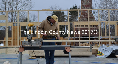 Richard Brown works on the rebuilding of the Freedom Center in Dresden on Friday, March 24. Construction began the week before. (Abigail Adams photo)