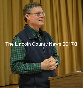 """Moderator Carl """"Chip"""" Griffin calls a special town meeting to order Monday, March 27. (Abigail Adams photo)"""