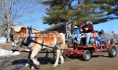 Adam Rice and his Haflingers take young Maine Maple Sunday visitors for a horse-and-wagon ride. (J.W. Oliver photo)