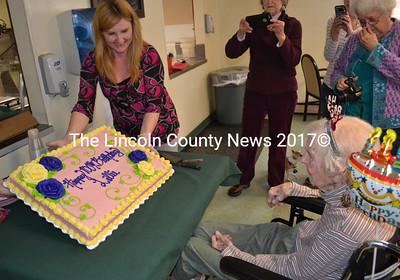 Country Manor Nursing Home Activities Director Tammy Brann shows Lillie Weissenberger her 100th birthday cake Monday, March 27. (Abigail Adams photo)