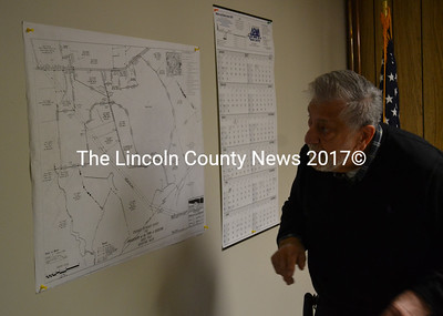 Edgecomb Board of Selectmen Chair Jack Sarmanian looks at a map of the Lallis property during a meeting of the board Monday, March 27. (Abigail Adams photo)