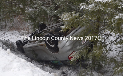Snowy road conditions contributed to a rollover on East Pond Road in Nobleboro the morning of Wednesday, March 22. (Alexander Violo photo)