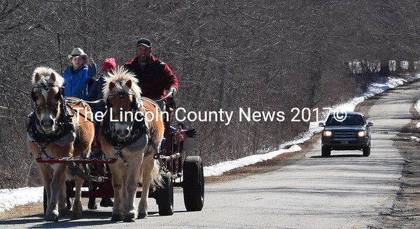 Morton and Chubby pull a wagon full of enthusiastic kids along Split Rock Road in Walpole on Maine Maple Sunday, March 26. Rice Farms Maple Syrup owner Adam Rice is at the reins. (J.W. Oliver photo)
