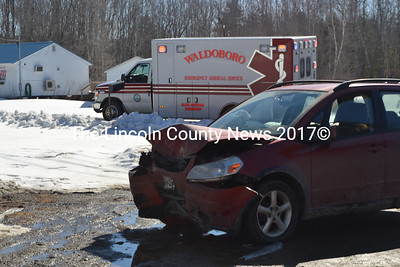 All five occupants of a Suzuki hatchback were transported to the hospital after the car crashed into a veterans monument on Route 32 in Jefferson. (Alexander Violo photo)
