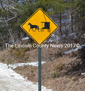 A sign on Route 218 in Whitefield cautions motorists to be aware of horse-and-buggy traffic. (Abigail Adams photo)