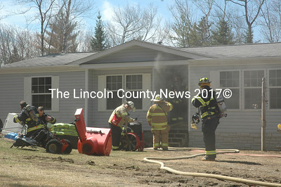 Firefighters set up a fan to clear the home of smoke after a fire on South Clary Road in Jefferson. (Alexander Violo photo)