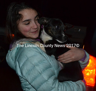 Casey Nelson holds Violet, the puppy her family will foster. The Nelsons, of Damariscotta, volunteer with Underhound Railroad, a nonprofit orgainzation that provides forster homes for dogs rescued from high-kill shelters. (Maia Zewert photo)