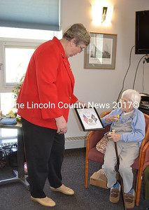 Wiscasset American Legion Auxiliary Secretary Diane Munsey presents a 70-year membership certificate to Ruth Applin. (Charlotte Boynton photo)