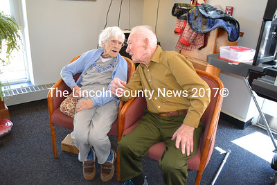 Ruth Applin, age 100, and her brother Arthur Jones, age 99, share a special moment during an open house Saturday, April 15, to celebrate Ruth's 100th birthday, at the Wiscasset Community Center. (Charlotte Boynton photo)