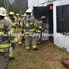 Volunteer firefighters enter a burning building at the Gordon Merry Training Facility in Wiscasset on Saturday, April 22. (Abigail Adams photo)