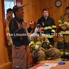 """The skills learned by firefighters during the two-month basic firefighter certification course """"all come into play today,"""" Lincoln County Fire Academy instructor David Pratt said at the final training of the academy's largest class in recent years. (Abigail Adams photo)"""