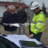Maine Department of Transportation Region 2 Traffic Engineer David Allen (right) discusses potential driveway locations for the Dollar General development at the corner of Main Street and Biscay Road in Damariscotta as Damariscotta Town Planner Tony Dater looks on during a site walk Tuesday, April 25. (Maia Zewert photo)