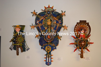 """Three found-object assemblage pieces by Bowdoinham artist Howard Solomon hang at the """"Artist's Choice"""" show currently on exhibit in the main gallery of River Arts in Damariscotta. (Christine LaPado-Breglia photo)"""