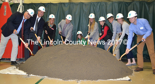 The CLC YMCA ceremonially breaks ground on the first phase of its expansion project during its annual meeting Tuesday, May 9. From left: John Scott, of J.F. Scott Construction Co.; CLC YMCA Board of Directors Chair Dennis Anderson and CEO Megan Hamblett; architect Tor Glendinning, Y member Reese Nelson, Y staff member Molly Saunders, Janice Sprague, Jacob Masters, and Brie Wajer and Evan Eckel, the youth representatives on the Y board. (Maia Zewert photo)