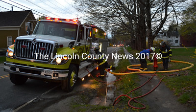 Newcastle firefighters conduct a hydrant check on Mills Road the evening of Tuesday, May 9 as part of a training exercise. (Maia Zewert photo)