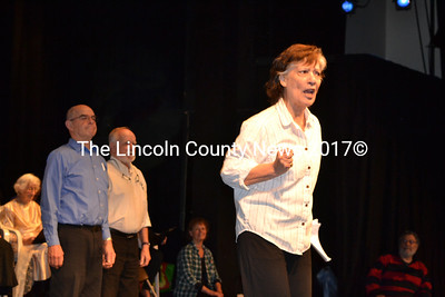 """John Harris and Gene Reil look on as Carol Cirigliano performs in the opening segment of """"Love That Song"""" during the May 2 dress rehearsal for Hearts Ever Young's upcoming production at Lincoln Theater. (Christine LaPado-Breglia photo)"""