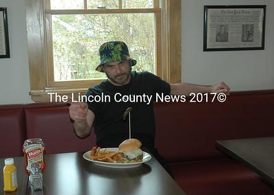 Mario Panagos with one of his burger creations at the Burger Bar in Waldoboro. (Alexander Violo photo)