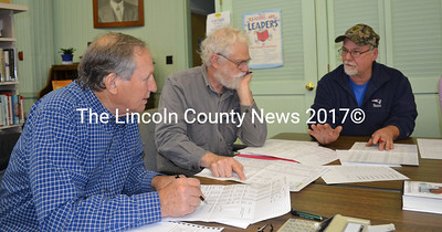 From left: Dresden Budget Review Committee Chair Peter Walsh and member David Probert review the municipal budget with Third Selectman Allan Moeller during the final joint meeting of the budget committee and the selectmen Wednesday, May 10. (Abigail Adams photo)