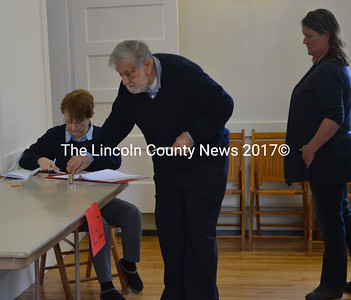 Edgecomb Board of Selectmen Chair Jack Sarmanian votes by secret ballot on an education budget warrant article during annual town meeting at the town hall Saturday, May 13, with new Edgecomb School Committee member Heather Sinclair next in line. (Abigail Adams photo)