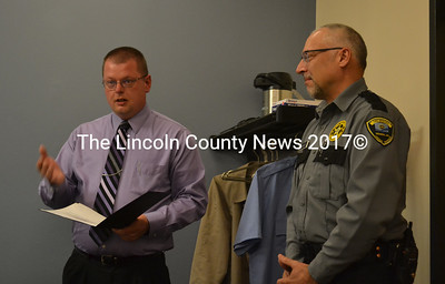Capt. James Bailey, acting administrator of Two Bridges Regional Jail, names Correctional Officer Derek Maroon the Officer of the Month for April during the Lincoln and Sagadahoc Multicounty Jail Authority Board of Directors meeting Wednesday, May 10. (Abigail Adams photo)