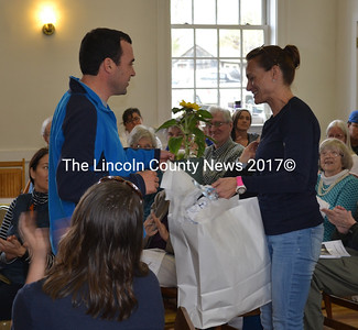 Edgecomb School Committee Chair Tom Abello presents outgoing member Sarah Clifford with a gift at Edgecomb's annual town meeting Saturday, May 13 as a thank you for her seven years of service on the committee. (Abigail Adams photo)